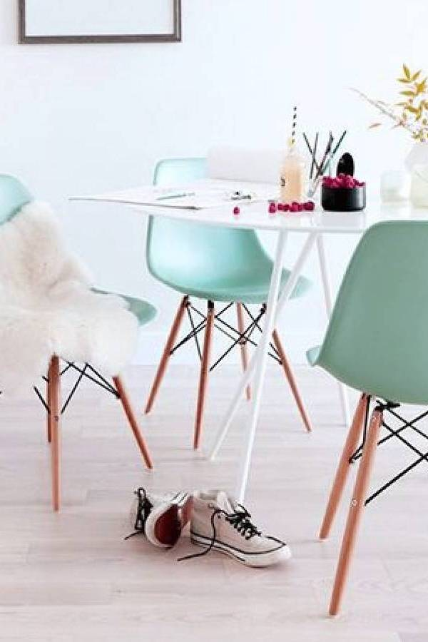 Eames style dining chairs in soft pastel colours