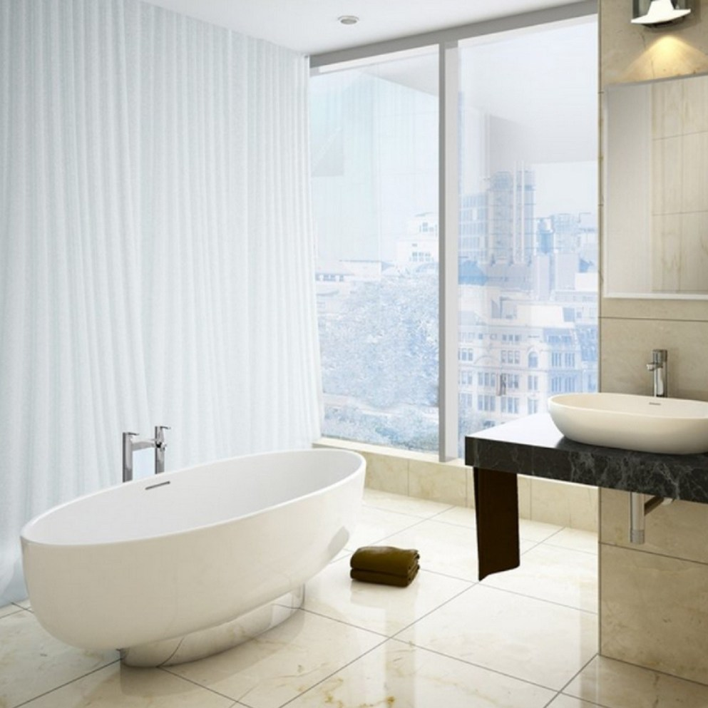 Oh to be taking a bath in this! The modern bath is made from natural stone and sits on a shiny chrome plinth,.