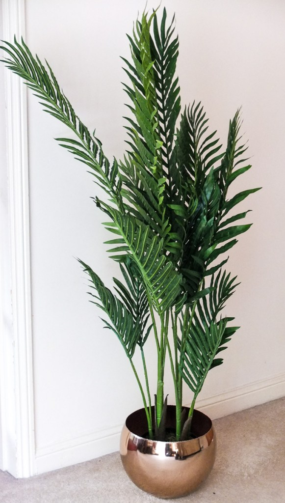 Add a tropical feel to your home with an artificial Paradise Palm plant