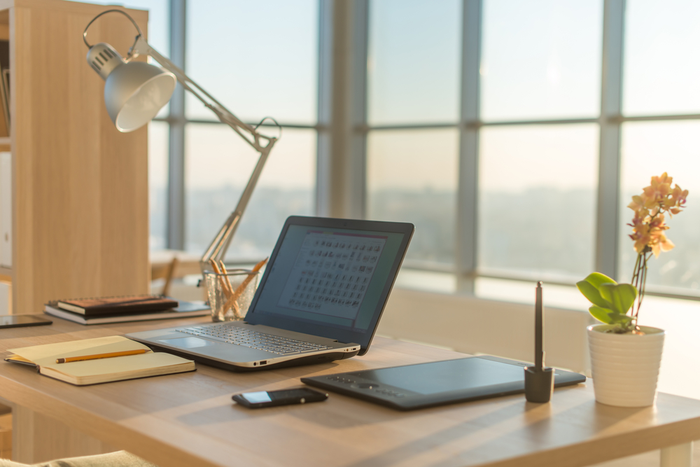 Great looking desk area with a useful task lamp light