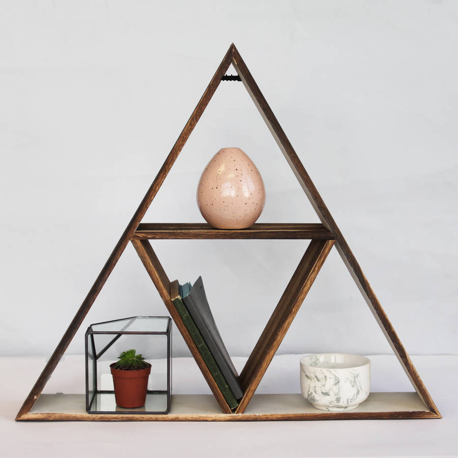 Use this eye-catching triangle geometric shelf to display your favourite small ornaments and treasures