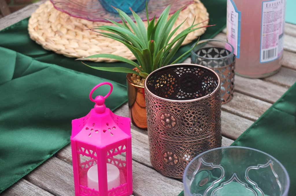 Add tealight holders, candles and lanterns to an outside table for evening alfresco dining