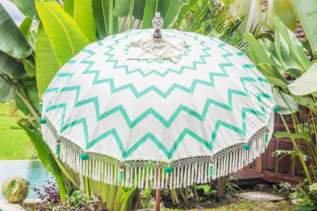 Big bold and beautiful Diana Ross turquoise sun shade from the East London Parasol Company