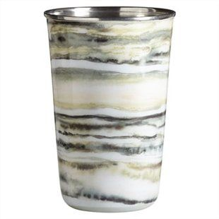 Love this unusual scented candle. The tonka bean scent is in an enamelled tumbler that looks like marble.