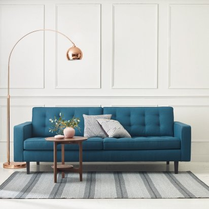 Gorgeous metallic copper floor lamp that's perfect for a contemporary living room