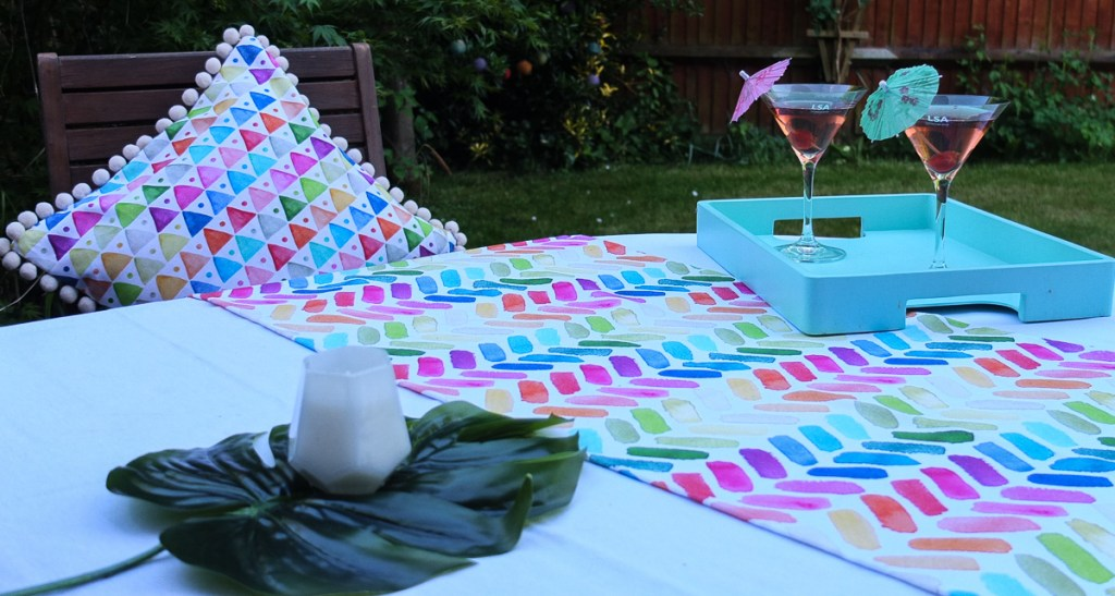 Love the way these bright and cheery textiles transform a plain wooden table in an instant