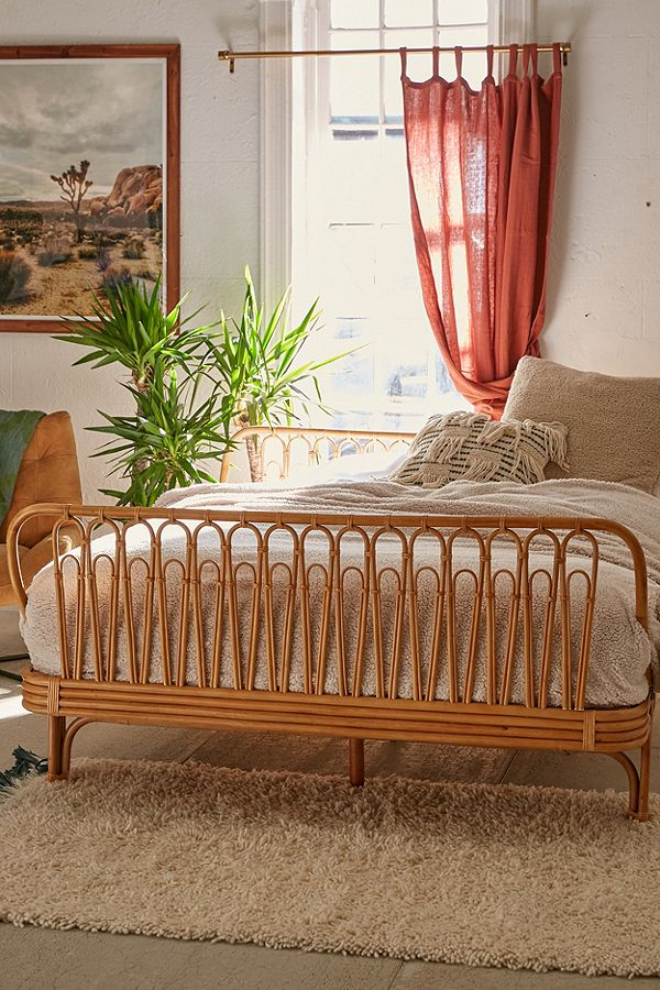 Isn't this rattan bed gorgeous?