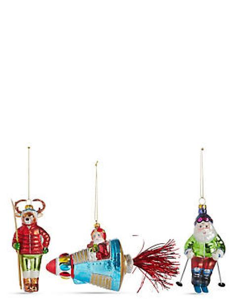 Decorate your tree with this quirky set of travelling Santa decorations