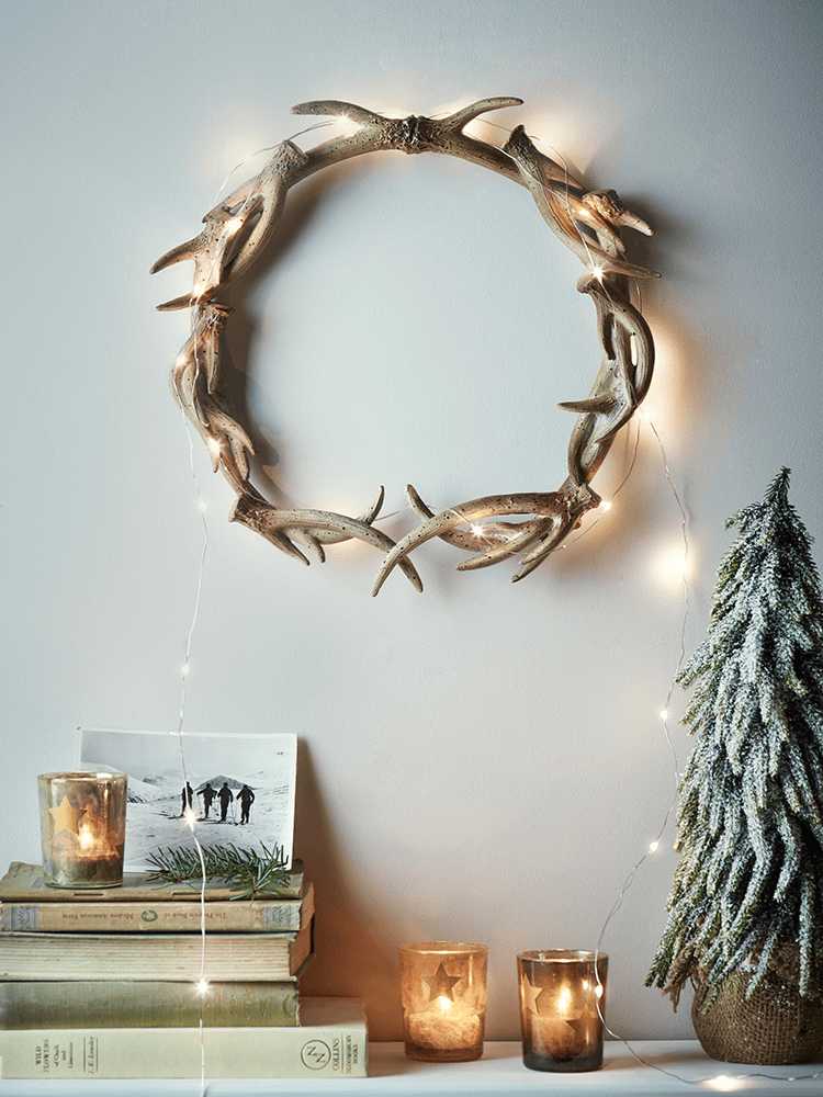 Unusual seasonal hanging wreath decoration made to look like antlers