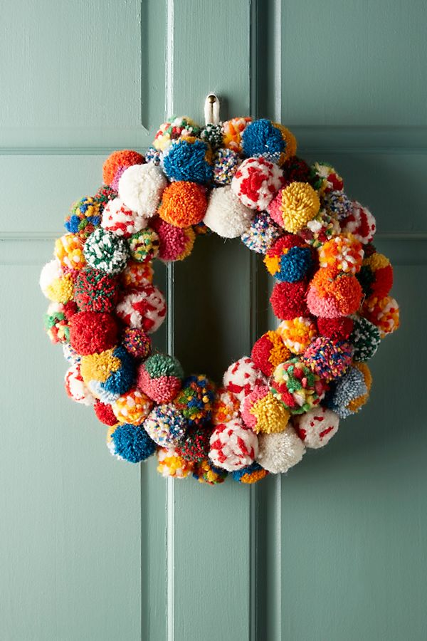An explosion of colourful pom poms adorn this hanging decoration