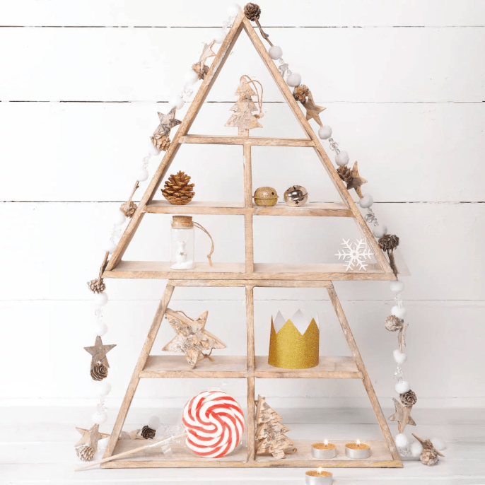 Display small Christmas treasures and trinkets on this Christmas tree shelf