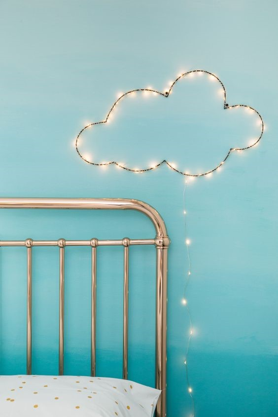 Save space on a bedside lamp by having a wall light instead. This cloud design light is perfect for a child's bedroom.