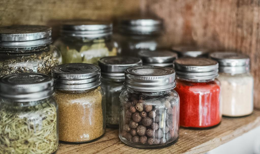 Use glass storage jars like mason jars instead of plastic ones for a more eco-friendly kitchen