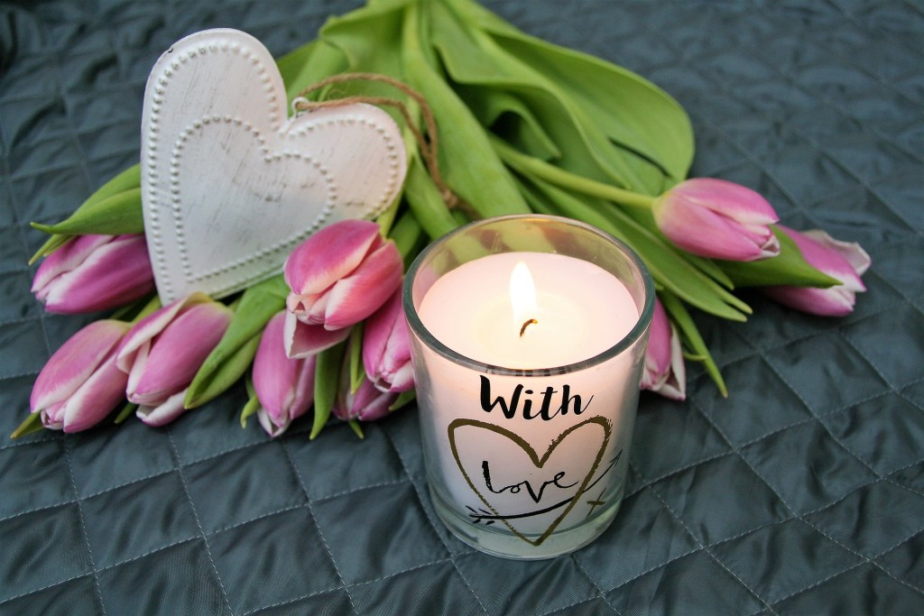 Add some home comforts such as flowers and scented candles to your woman cave  or she shed