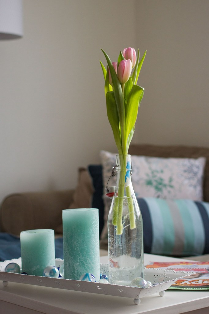 Fresh flowers or plants can add a nice touch to a living room and help freshen the space