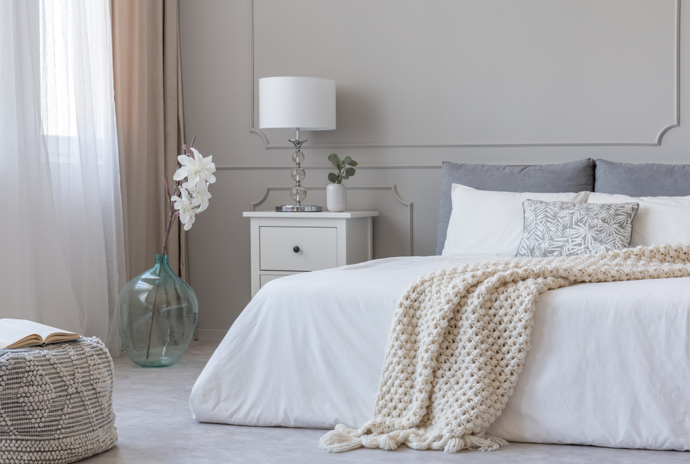 A modern country chic bedroom design featuring a soft grey and white colour palette