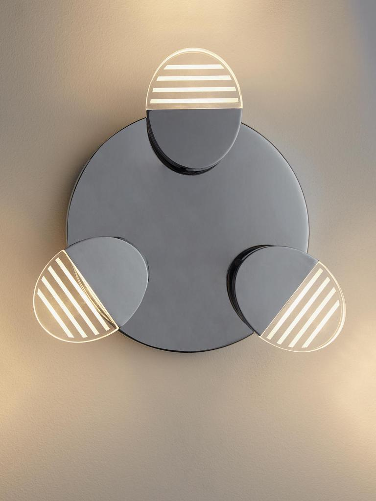 Modern and quirky bathroom wall light, with directional heads for functional bathroom lighting.