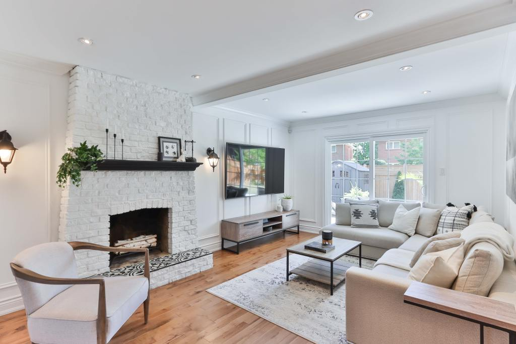 Wooden flooring and well placed rugs can create a luxurious space in your home