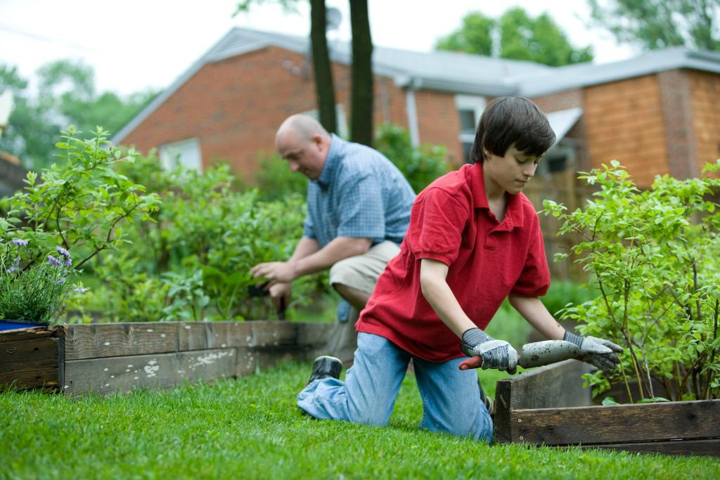 Gardening together can be a great father and son bonding activity