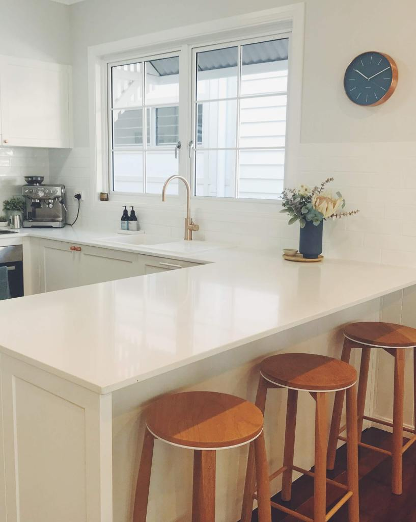 A kitchen breakfast bar provides additional eating space