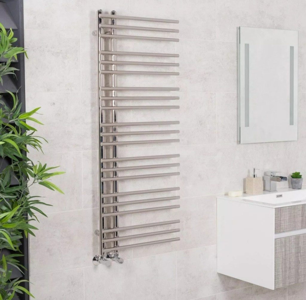 Designer curved ladder rail style radiator which works great in a bathroom