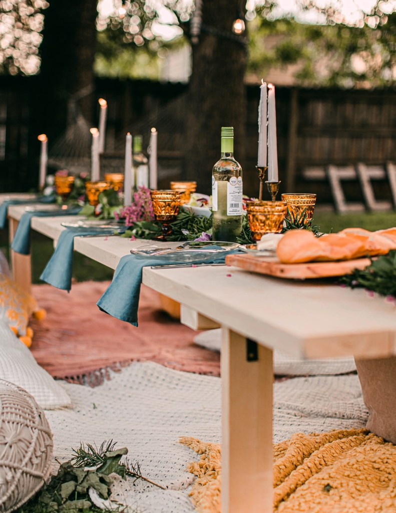 Use throws and cushions to add comfort, colour and texture at an outdoor party