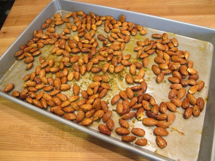 With a few herbs and spices and a quick roast in the oven, you can make ordinary healthy almonds shine with this Savory Roasted Almonds recipe.