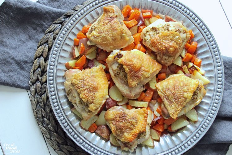 With only 8 non-pantry ingredients, you won't spend your whole evening making this Garlic-Mustard Chicken and Vegetables Sheet Pan Dinner! It's a perfect weeknight meal that is family-friendly too. With well-loved veggies of potatoes and carrots, you won't have to bargain with your kids to get them to eat their vegetables! That's a win!