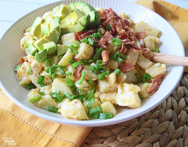 Next time you need an egg free salad everyone will love, make this Bacon-Avocado Egg-Free Potato Salad. Not only will your guests who have an egg allergy or intolerance thank you, all of your other guests will love it too! The avocado stands in nicely for the classic hard-cooked eggs, and a simple cider vinegar and mustard based dressing makes this potato salad bright and flavorful – no mayonnaise needed!