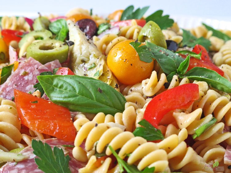 For a gluten free, dairy free healthy salad recipe that is full of flavor and totally customizable, make this Italian Pasta Salad. Even though the vinaigrette only has a few ingredients, it adds so much flavor to the salad because of the way the ingredients are used. This makes enough for a crowd and is the perfect salad to take to your next potluck, picnic, tailgate, or party!