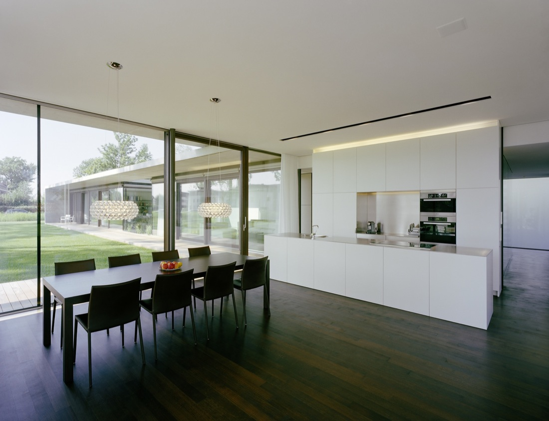White Kitchen Dark Wood Floor Dining Table Cantilevered