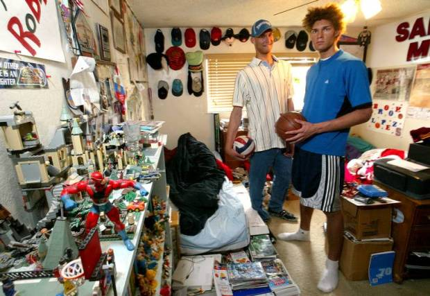 Twins Brook, left, and Robin Lopez, pose for a photo in March 2006 in the Fresno bedroom they shared. Filled with toys, comic books and memorabilia, it gave a hint to their eclectic nature.