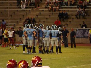 Bullard in a huddle