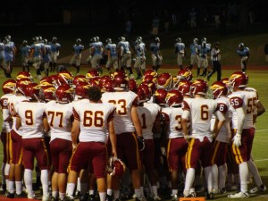 Clovis West in a huddle before start of second half.