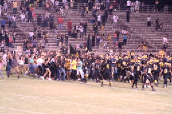 Edison Fans rushing the field after the blocked field goal to finish the game.