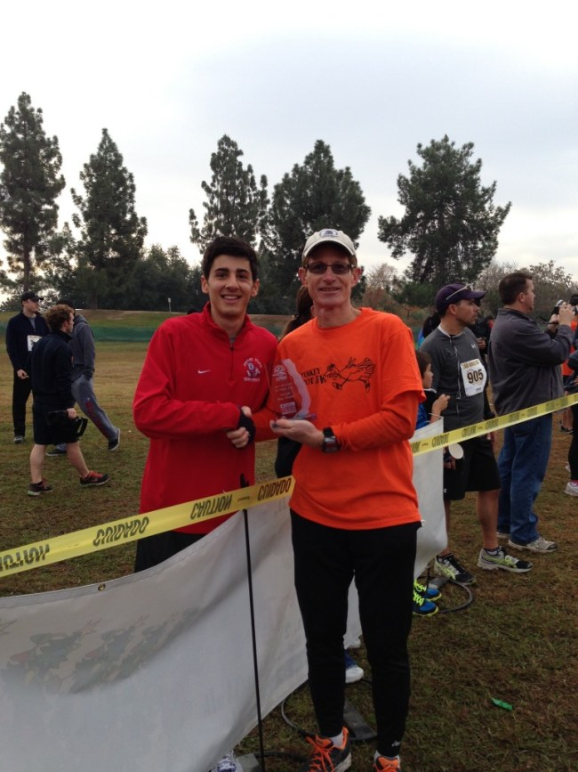 Race Director John Volkman (in orange) with last year's overall winner, Daniel Vartanian