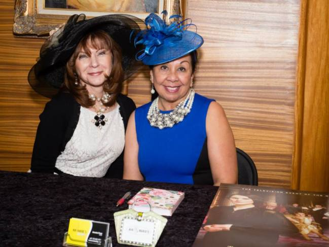 Annette Perez, left, and a friend model hats from Ava Marie's.