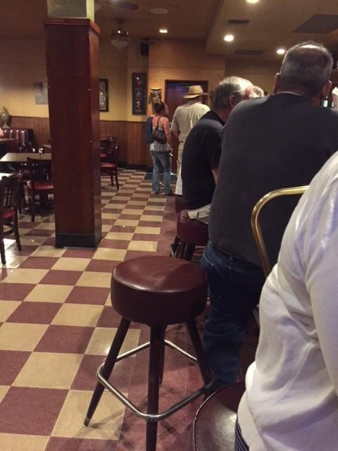 People sitting at the bar at The Cosmopolitan Tavern