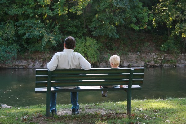 Father and son sitting on a bench