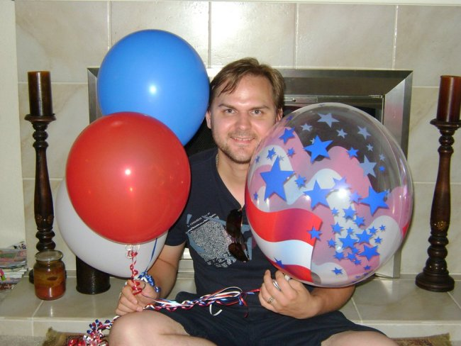 Red, white and blue balloons commemorate Vlad's new citizenship.