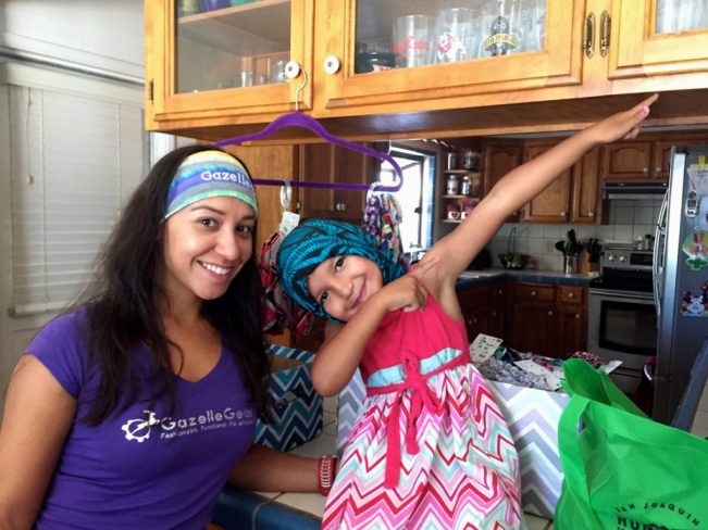 Farin Montanez and her daughter model two different ways to wear Gazelle Gear buffs.