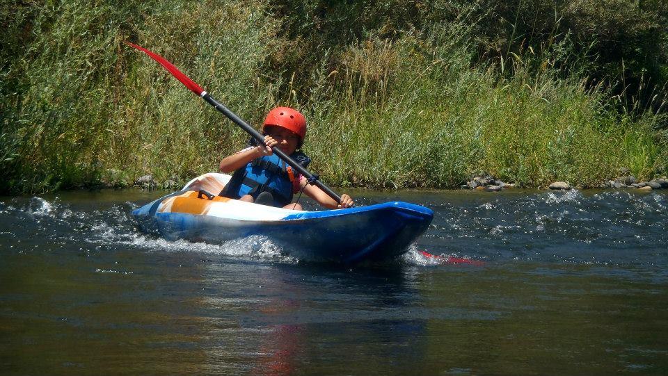 Kid kayak on the river
