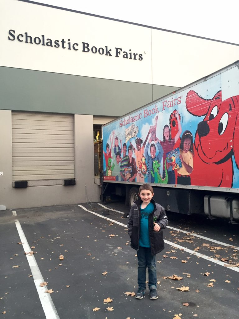 Standing in front of the Scholastic Warehouse Sale!