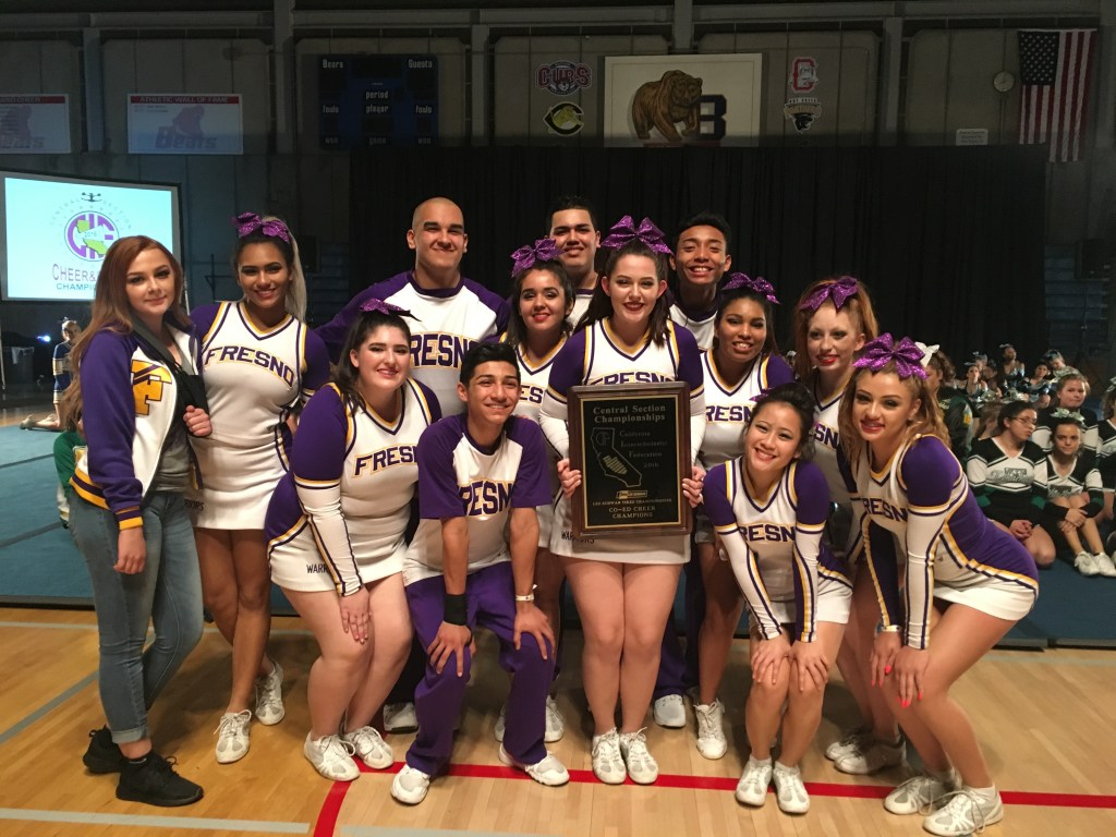 Fresno High's cheer squad holding plaque