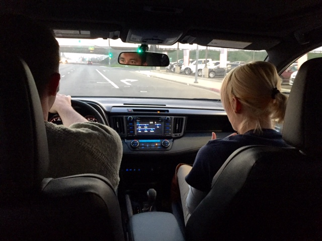 My husband, on a test drive with our favorite sales person, Marissa