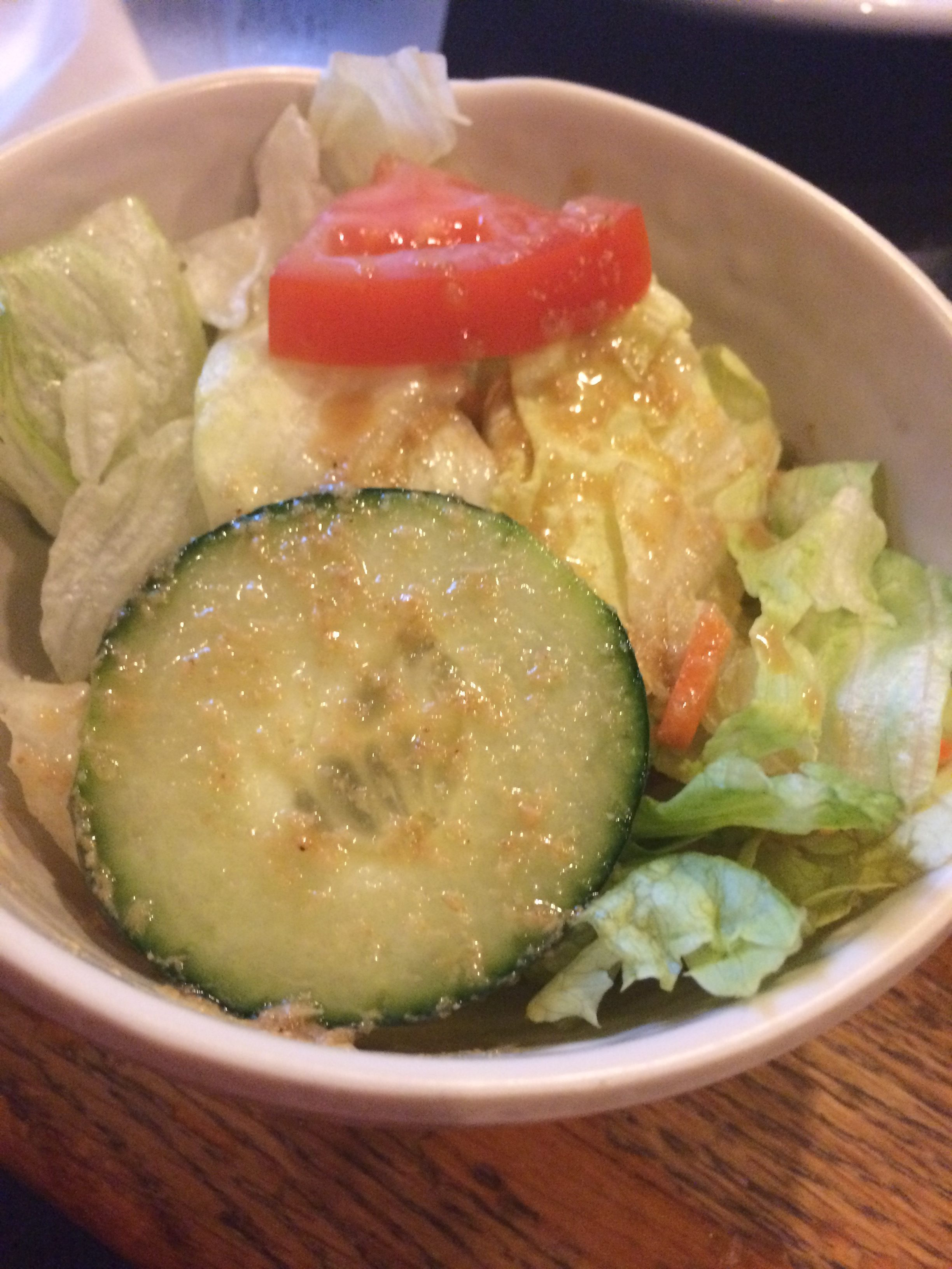 The salad looks basic, but it's the dressing that makes it yummy. It's a sweet based vinaigrette.