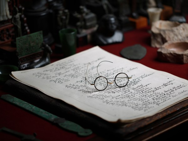 Sigmund Freud's diary and spectacles on his desk.