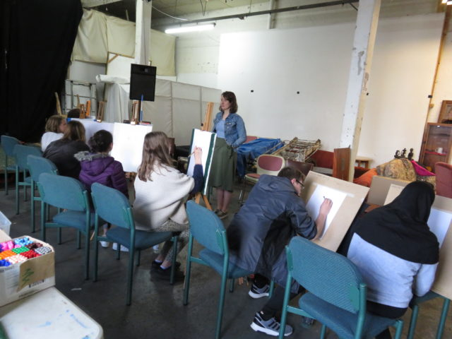 young people learning drawing