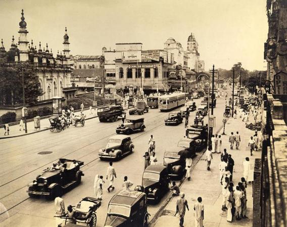 Chowringhee Square. The Mohammddan mosque, Juma Masjid, is shown at left. This is actually one of thequiet moments when GI trucks, taxis, bicycles and other modes of transport can move with comparative freedom.