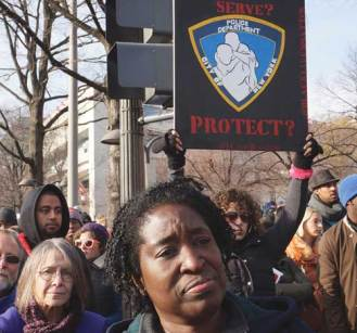 A woman at a protest against police brutality led by Reverend Al Sharpton on Pennsylvania Avenue in Washington, D.C., on December 13, 2014.
